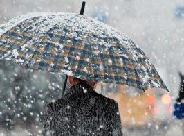 снігопад людина під парасолькою